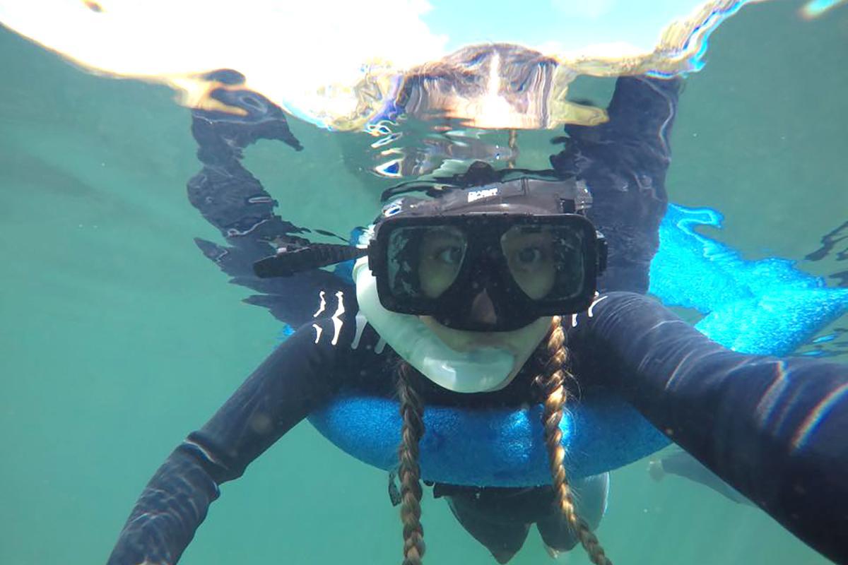Student snorkeling