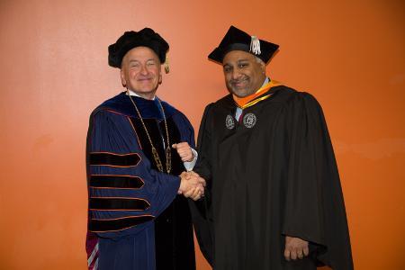 Hynes with graduate
