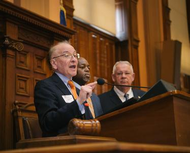 Hynes speaking at the Capitol